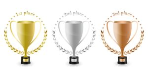 Sport trophies for the first place, second place and third place with laurel wreath and stars. Gold, silver and bronze trophy. Vec Royalty Free Stock Photography