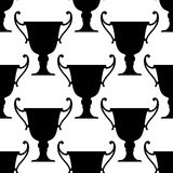 Sport trophy cups seamless pattern. With black ornate bowls with handles Royalty Free Stock Images