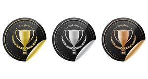Sport trophy  icons for the first place, second place and third place with laurel wreath and stars. Gold, silver and bronze. Royalty Free Stock Photos