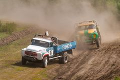 Sport trucks racing on unpaved track Stock Image