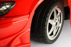Sport tyre in the red car Royalty Free Stock Photos