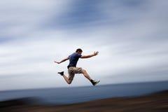 Sport- und Energiekonzept - bemannen Sie laufendes schnelles Stockbilder