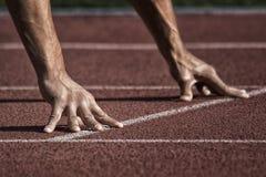 Sport. Unrecognizable runner on the starting Stock Image