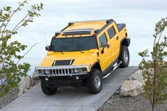 Sport Utility 2. A big yellow 4X4 sport utility with a shiny chrome grille and guard system made for climbing around rough terrain stock images