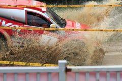 Sport utility vehicle burst into puddle Stock Images