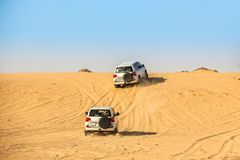 Sport Utility Vehicle Driving during the Sahara desert stock photography