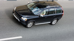 Sport utility vehicle on road. Overhead view of black sport utility vehicle driving on road Stock Photography