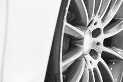Sport vehicle alloy wheels detail. Car parts Royalty Free Stock Image