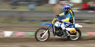 Sport vintage motocycle race. Woodland, WA/USA-FEBRUARY 9: Motocross vintage motocycle race. American small town track. February 9, 2013 in Woodland, Washington Stock Photo