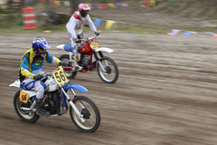 Sport vintage motocycle race. Woodland, WA/USA-FEBRUARY 9: Motocross vintage motocycle race. American small town track. February 9, 2013 in Woodland, Washington Royalty Free Stock Photos
