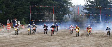 Sport vintage motocycle race. Woodland, WA/USA-FEBRUARY 9: Motocross vintage motocycle race. American small town track. February 9, 2013 in Woodland, Washington Stock Image