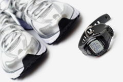 Sport Watch And Running Shoes Royalty Free Stock Photos