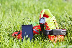 Sport watch, chest strap of a heart rate monitor, smartphone. Stock Image