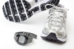 Sport watch and running shoes Royalty Free Stock Image