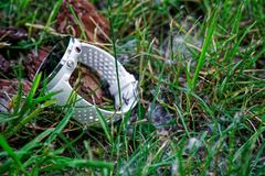 Sport watch for running white color on the ground in the grass. Fitness watch for tracking daily activity and strength training. Sport watch for running white stock photography