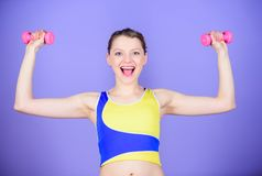 Sport is the way of her life. Healthy lifestyle concept. Fitness exercises with dumbbells. Workout with dumbbells. Girl stock photography