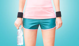 Sport wear, woman with water. Fitness wear or equipments, woman Royalty Free Stock Photo