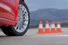 Sport wheel and cones. Aluminium sport wheel and cones, Wheel on a red sport car Stock Images