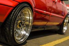 VW WHEEL TIRE NUT TURBO. SPORT WHEEL TIRE NUT FENDER BUMPER CAR LENS SPOILER DOOR RING CHROME BLACK VW VOLKS WAGEN STEERING Stock Photography