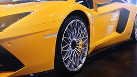Wheels of a modern sport car. The lights of the yellow car. Modern Car exterior details. Sport wheels of a modern car. Exotic yellow car. Modern Car exterior Stock Images