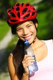 Sport woman. Excercise woman. Beautiful young woman enjoying a bottle of water outdoors during a bike trip Stock Photos