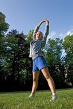 Sport and woman. Woman making of the sport in full nature Royalty Free Stock Photography