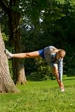 Sport and woman. Woman making of the sport in full nature Stock Photos