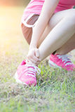 Sport woman ankle injury Royalty Free Stock Photography