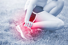 Sport woman ankle injury stock photo