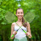 Sport woman with badminton rackets Stock Image