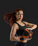 Sport woman with a ball in his hands. Sport brunette with yamchikom in hands on a black background Royalty Free Stock Images