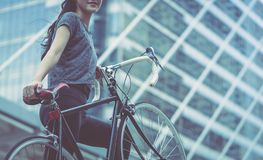Sport woman carrying her bike up the stair royalty free stock image