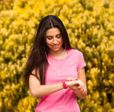 Sport woman checking her watch Royalty Free Stock Image