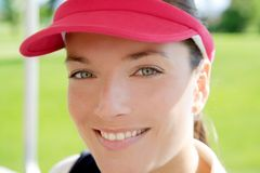 Sport woman closeup face sun visor cap. Sport woman closeup portrait face similing sun visor cap tennis golf Stock Photo