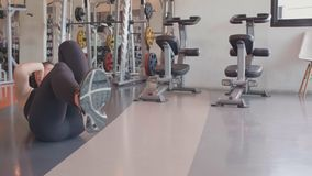 Sport woman doing bicycle crunching sit up on floor in fitness gym. People lifestyles and workout sport training club activity. Concept. Bodybuilder and weight stock video