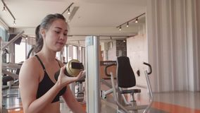 Sport woman doing bicycle crunching sit up on floor in fitness gym. People lifestyles and workout sport training club activity. Concept. Bodybuilder and weight stock footage