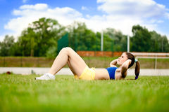 Sport woman doing exercise Stock Photos