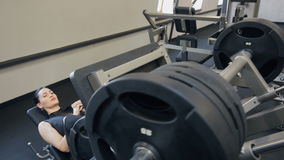 Sport woman doing exercises sitting on trainer in gym stock video footage