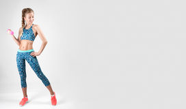 Sport woman doing fitness exercise with dumbbells. On white background Stock Images