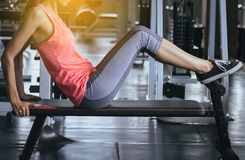 Sport woman doing situp or crunches in gym,Female exercise muscular her stomach,Close up royalty free stock photos