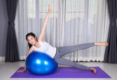 Woman doing yoga exercise with fitness ball Stock Photography