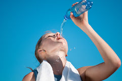 Sport  woman drinking water Royalty Free Stock Photography