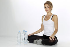 Sport woman drinking water Stock Images