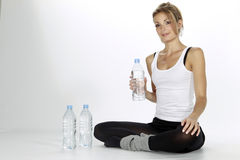 Sport woman drinking water Stock Photography