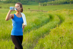 Sport woman drinking water Royalty Free Stock Photo