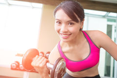 Sport woman with dumbbell Stock Photo