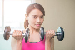Sport woman with dumbbell Stock Images