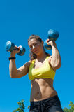 Sport woman with dumbbells on playground Stock Photo