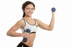 Sport woman with dumbbells Stock Photos