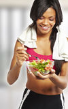 Sport woman eating salad Stock Photography